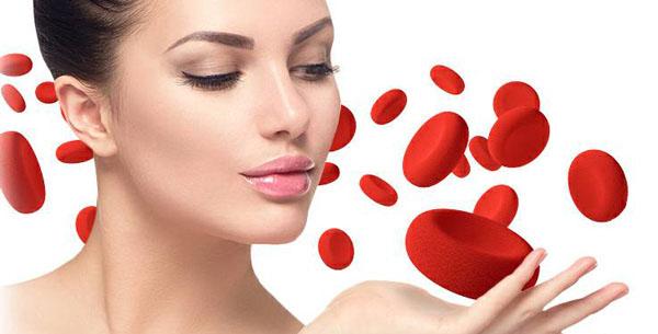 twarz kobiety i krwinki czerwone